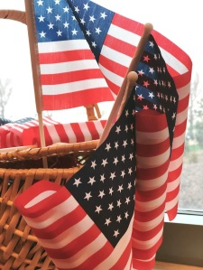 hand held U.S. flags in a basket